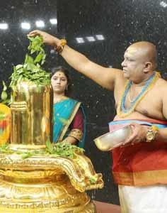 gold linga abhishekam with bilva patra
