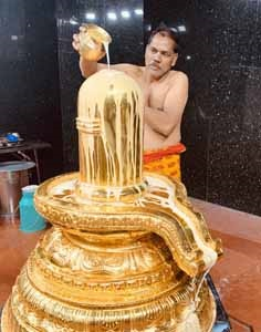 gold linga abhishekam by Visitor